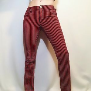DIVIDED red + black striped skinny jeans